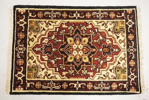 ANTIQUE HAND WOVEN ORIENTAL RUG MEASURING 2 FT X 2 FT 10 INCHES.