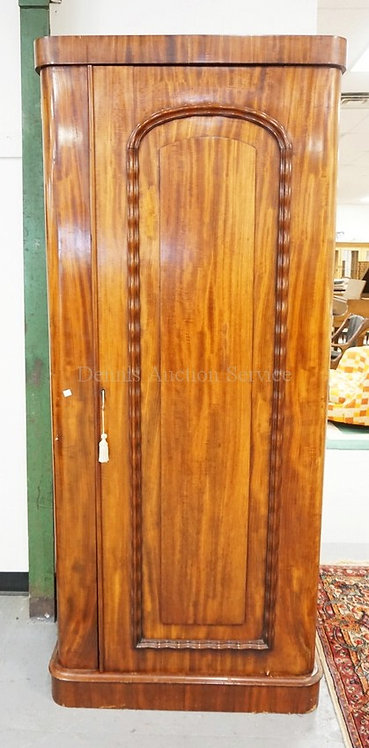 NARROW ARMOIRE WITH A PANELED DOOR WITH A MIRROR ON THE INTERIOR. 79 INCHES HIGH