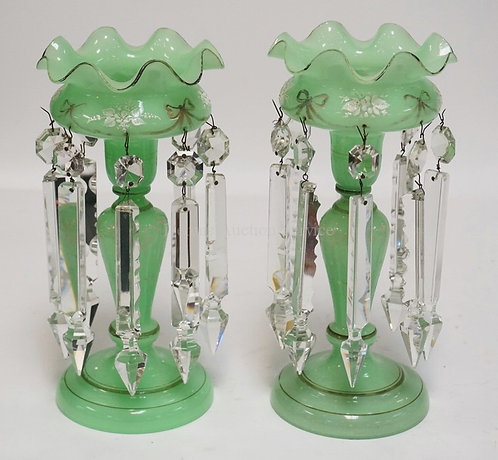 PAIR OF GREEN GLASS LUSTRES WITH ENAMELED DECORATION AND CUT PRISMS. ONE HAS BEE