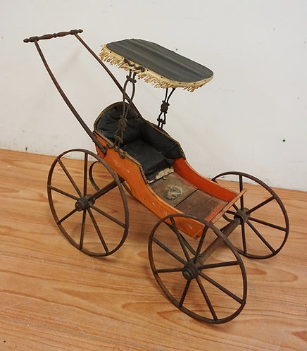 ANTIQUE VICTORIAN DOLL CARRIAGE MEASURING 26 INCHES HIGH.