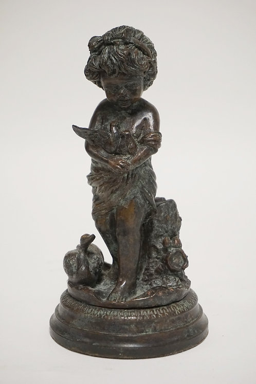 MAITLAND SMITH SCULPTURE OF A YOUNG GIRL HOLDING DOVES. 8 1/2 INCHES HIGH.