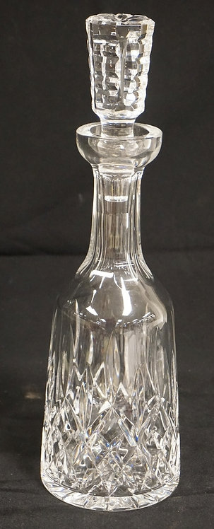 WATERFORD CRYSTAL DECANTER IN THE LISMORE PATTERN. 13 1/4 INCHES HIGH.