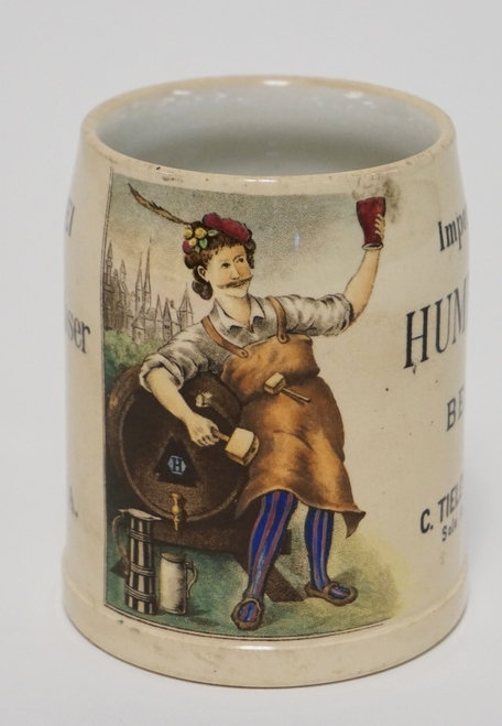 1046_METTLACH 1/4 L MUG. ADVERTISING FOR *HUMBSER* BEER. 4 INCHES HIGH.