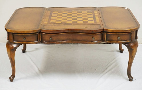 LEATHER TOP COFFEE TABLE WITH A FLIP CENTER TOP HAVING AN INLAID CHESS/CHECKER B