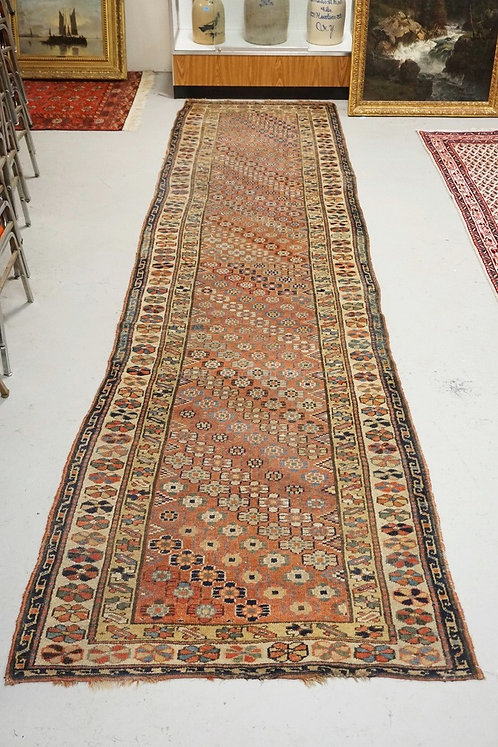 ANTIQUE HAND MADE ORIENTAL RUNNER MEASURING 13 FT 5 INCHES X 3 FT 9 INCHES.