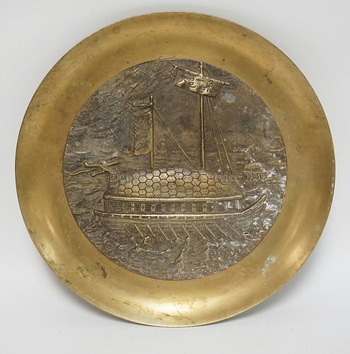 ASIAN BRONZE PLAQUE DEPICTING A LARGE OAR DRIVEN BOAT WITH A DRAGON FIGUREHEAD.