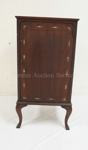 MAHOGANY MUSIC CABINET WITH MOTHER OF PEARL INLAY. 39 1/2 INCHES HIGH. 19 3/4 IN