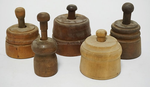 LOT OF 5 PRIMITIVE WOODEN BUTTER MOLDS/PRESSES. TALLEST IS 6 1/4 INCHES.