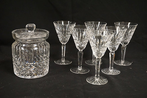 7 PIECES OF WATERFORD CRYSTAL. SIX 6 1/2 INCH WINES AND A 6 3/4 INCH BISCUIT BAR