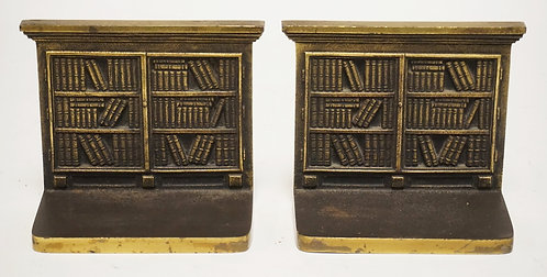 PAIR OF BRADLEY & HUBBARD CAST IRON BOOKENDS DEPICTING BOOKS ON SHELVES. 5 INCHE