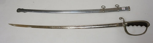 U.S.. MILITARY SWORD HAVING A WOODEN GRIP AND AN ENGRAVED BLADE. 35 1/4 INCHES L