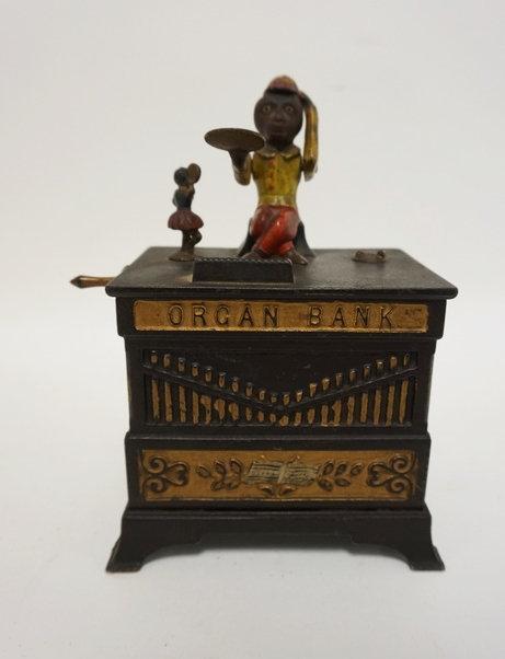 CAST IRON MECHANICAL *ORGAN BANK*. HAS A BELL INSIDE. ONE DANCER AND BOTTOM DOOR
