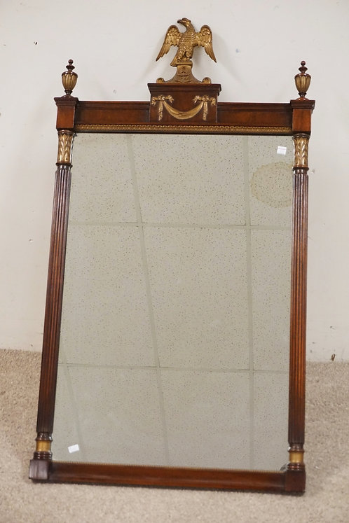 KINDEL MAHOGANY MIRROR WITH GOLD GILT ACCENTS INCLUDING AN EAGLE CREST. FLUTED C