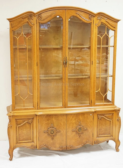 CHINA CABINET WITH BEVELED GLASS DOORS, APPLIED CARVINGS, AND GLASS SHELVES. 80