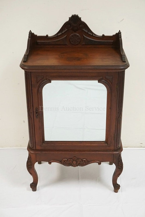 VICTORIAN MUSIC CABINET. CARVED WALNUT WITH A MIRRORED DOOR. SHEET MUSIC SHELVES