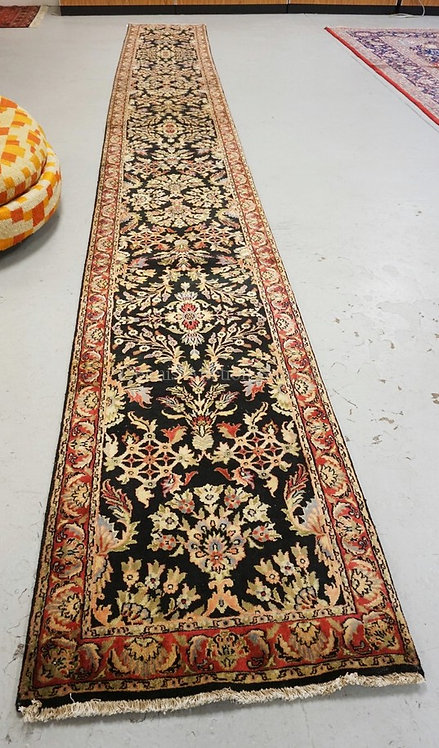 ORIENTAL RUNNER MEASURING 20 FT X 2 FT 6 INCHES.
