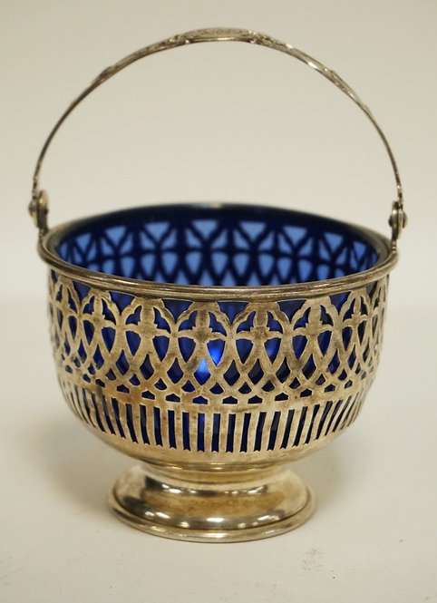 STERLING SILVER BASKET WITH A COBALT BLUE GLASS LINER. 5 INCHES HIGH.