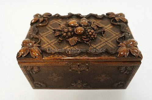 EXCEPTIONALLY WELL CARVED WALNUT BOX WITH FRUIT AND LEAVES IN DEEP RELIEF. 9 1/4