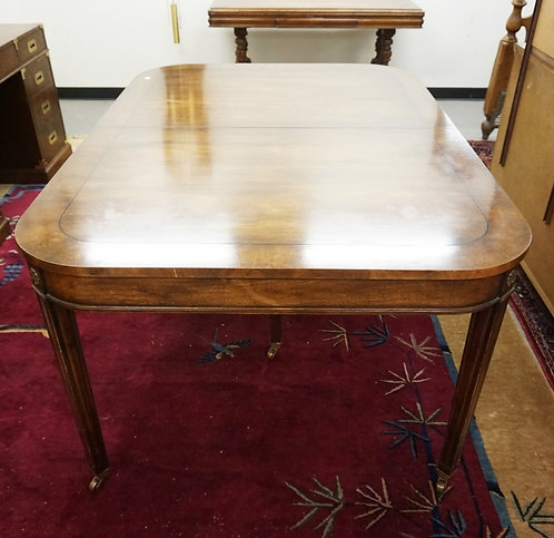 OLD COLONY FURNITURE CO DINING TABLE W/ROUNDED CORNERS AND BRASS ROSETTES. HAS 2