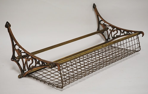 ANTIQUE RAILROAD OVERHEAD LUGGAGE RACK. IRON & BRASS. 29 3/4 INCHES LONG.