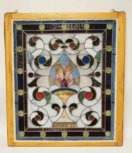 COLORFUL LEADED GLASS WINDOW WITH FACETED BULLSEYES 29 3/4 X 33 3/4 INCHES.