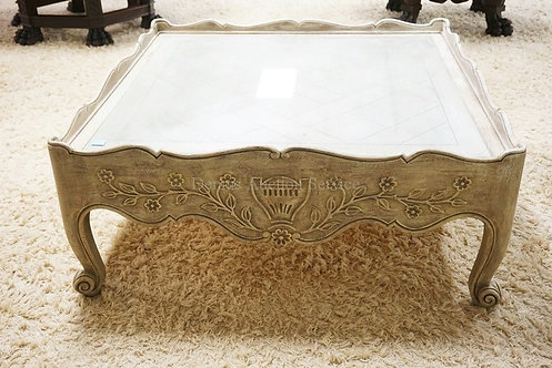 CARVED ASIAN STYLE COFFEE TABLE IN AN ANTIQUED WHITE FINISH. 42 INCHES SQUARE.