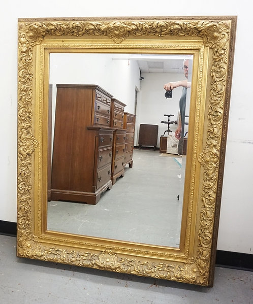 LARGE BEVELED MIRROR IN GILT FRAME. OVERALL DIMENSIONS 43 3/4 IN X 53 3/4 IN