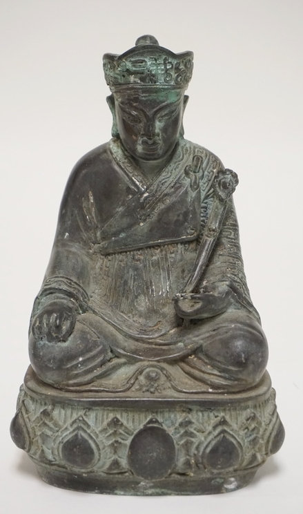 ASIAN BRONZE FIGURE OF A KNEELING MAN HOLDING A RUYI. 9 INCHES HIGH.