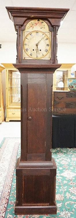 TALL CASE CLOCK WITH A HAND PAINTED WOODEN FACE. 86 3/4 INCHES HIGH.