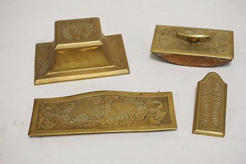 4 PIECE BRONZE DESK SET INCLUDING AN INKWELL, BLOTTER, CLIP, AND A PEN TRAY.