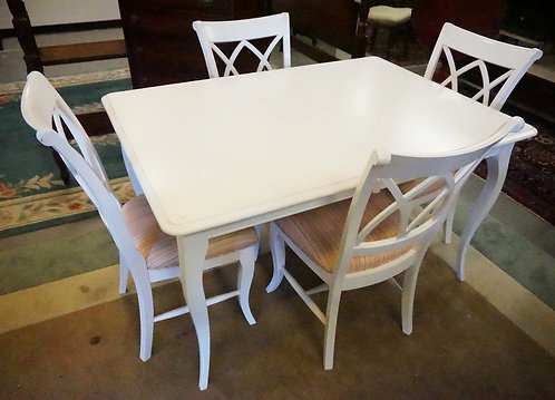 DINING TABLE WITH 4 CHAIRS IN WHITE. 38 X 54 INCH TOP PLUS A POP UP LEAF.