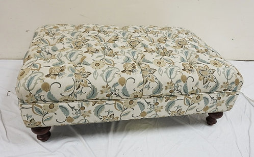 NEW FURNITURE LIQUIDATION LARGE TUFTED OTTOMAN WITH TURNED FEET. 45 IN X 29 IN