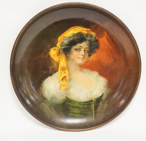 1051_LARGE TIN CHARGER DECORATED WITH THE PORTRAIT OF A WOMAN. 17 1/2 INCH DIA.