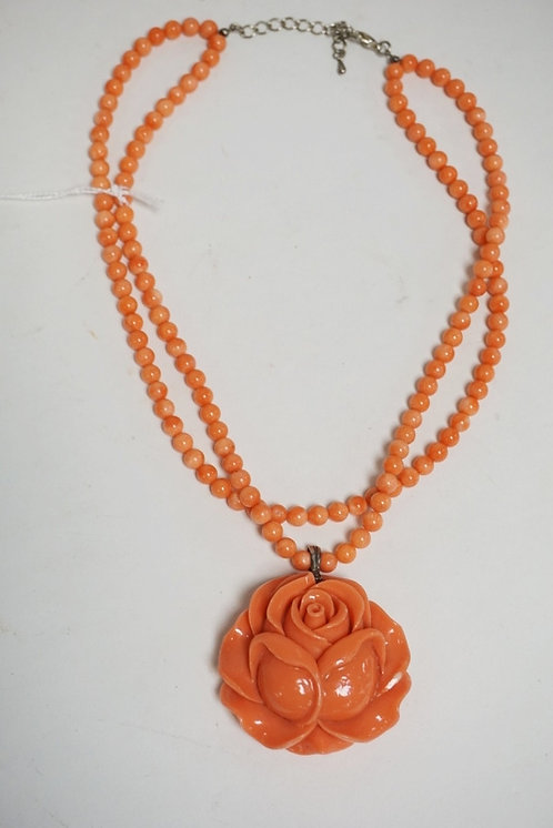 CARVED CORAL NECKLACE HAVING A LARGE ROSE FORM PENDANT MEASURING 2 3/16 INCHES W