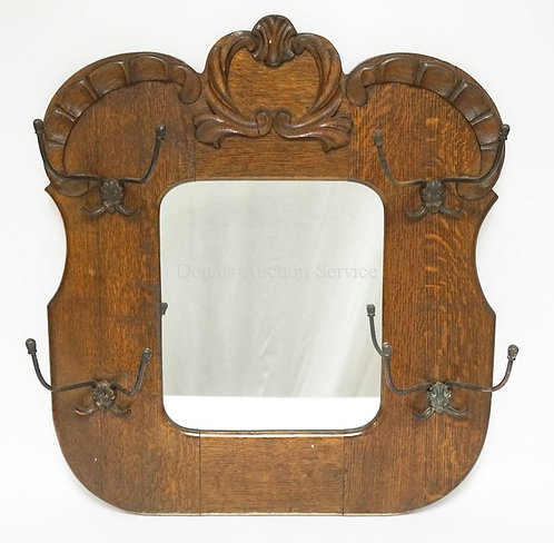 CARVED OAK HALL MIRROR WITH 4 DOUBLE COAT HOOKS. 23 3/4 IN WIDE, 26 3/4 IN H