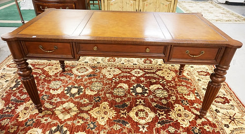 ETHAN ALLEN LEATHER TOP DESK WITH 3 DRAWERS AN FLUTED LEGS. 63 3/4 IN X 32 1/4 I