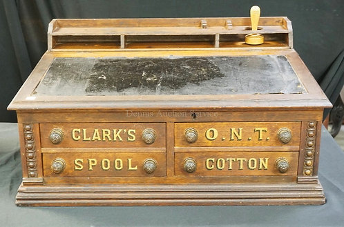 OAK CLARK'S SPOOL CABINET WITH A LIFT TOP WRITING DESK TOP. 29 3/4 INCHES WIDE.