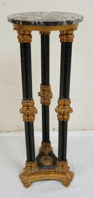 MARBLE TOP PEDESTAL. EBONIZED AND GOLD GILT. 33 3/4 INCHES HIGH. 12 INCH DIA.