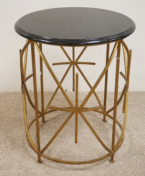 WROUGHT METAL STAND WITH A GRANITE TOP. 20 1/2 INCHES IN DIA. 25 INCHES HIGH.