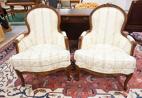 PAIR OF CARVED ARMCHAIRS WITH BROCADE UPHOLSTERY. 37 3/4 INCHES HIGH.