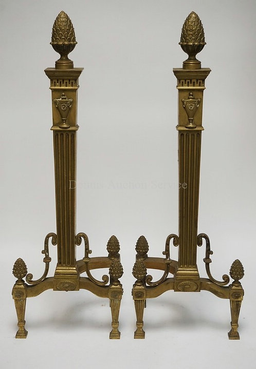 PAIR OF TALL BRONZE ANDIRONS WITH TAPERED AND FLUTED STEMS AND LEGS, FAN MEDALLI