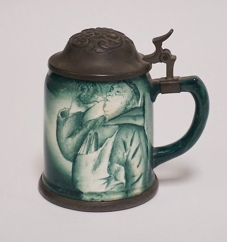 1045_GERMAN STEIN WITH AN IMAGE OF A DRINKING MONK AND A STONE ARCHWAY. 5 3/8 IN