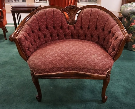 1081_CARVED WALNUT SETTEE WITH TUFTED UPHOLSTERY. 31 INCHES HIGH. 38 INCHES WIDE