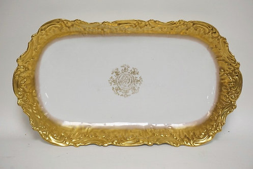 LIMOGES PORCELAIN OVAL BOWL WITH GOLD TRIM ON A MOLDED BORDER. 15 3/4 X 8 3/4 IN
