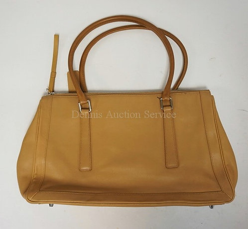 GENUINE COACH PURSE IN TAN LEATHER. 15 1/2 INCHES LONG. 9 INCHES HIGH.