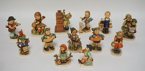LOT OF 13 HUMMEL FIGURES. TALLEST IS 5 1/8 INCHES.