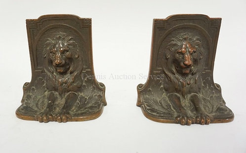 PAIR OF BRONZE LION BOOKENDS MEASURING 4 INCHES HIGH.