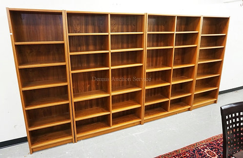 4 SECTION BOOKCASE MEASURING 153 INCHES WIDE.