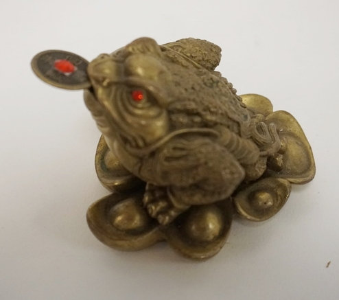 ASIAN BRONZE FROG WITH RED JEWEL EYES, HAS A REMOVABLE RED JEWELED COIN IN HIS M