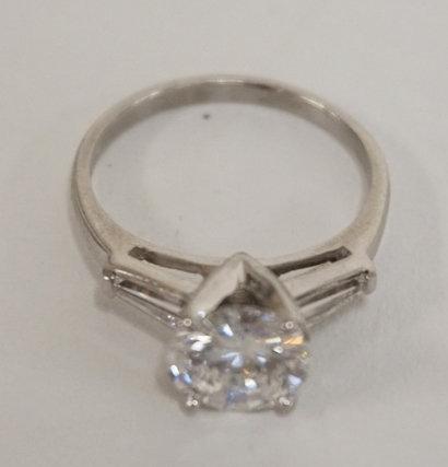 PLATINUM AND DIAMOND RING. LARGE DIAMOND IS 2.46 CARAT. 2 SIDE DIAMONDS. LARGE D